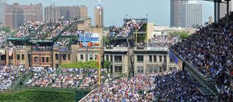 People sitting on rooftops at Wrigley